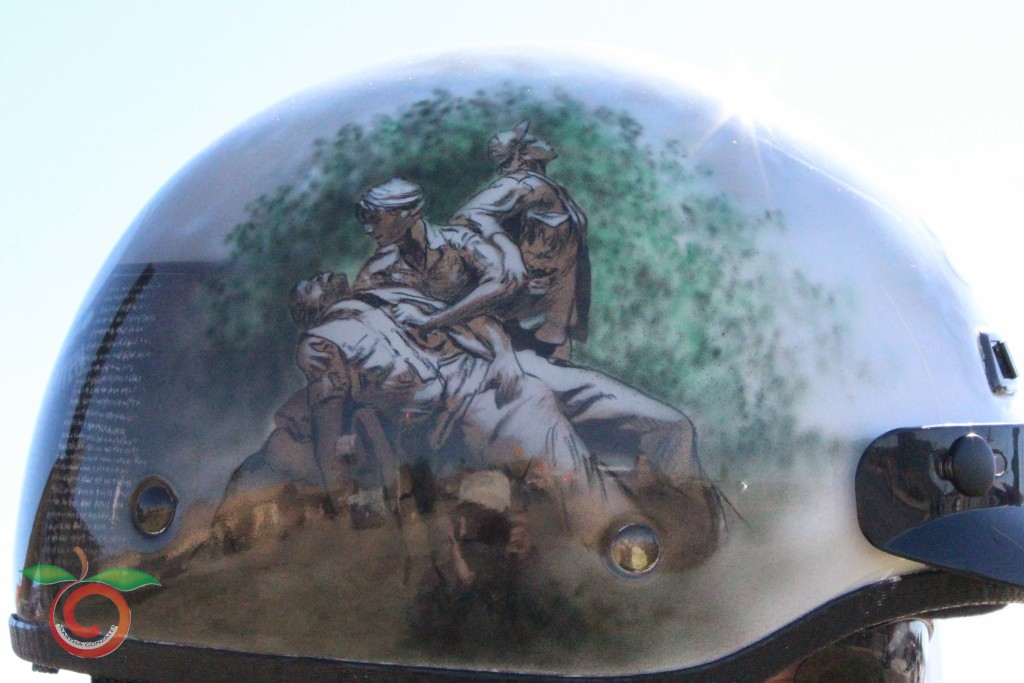 Freshly painted in Rio Rancho this helmet depicts scenes often seen in combat