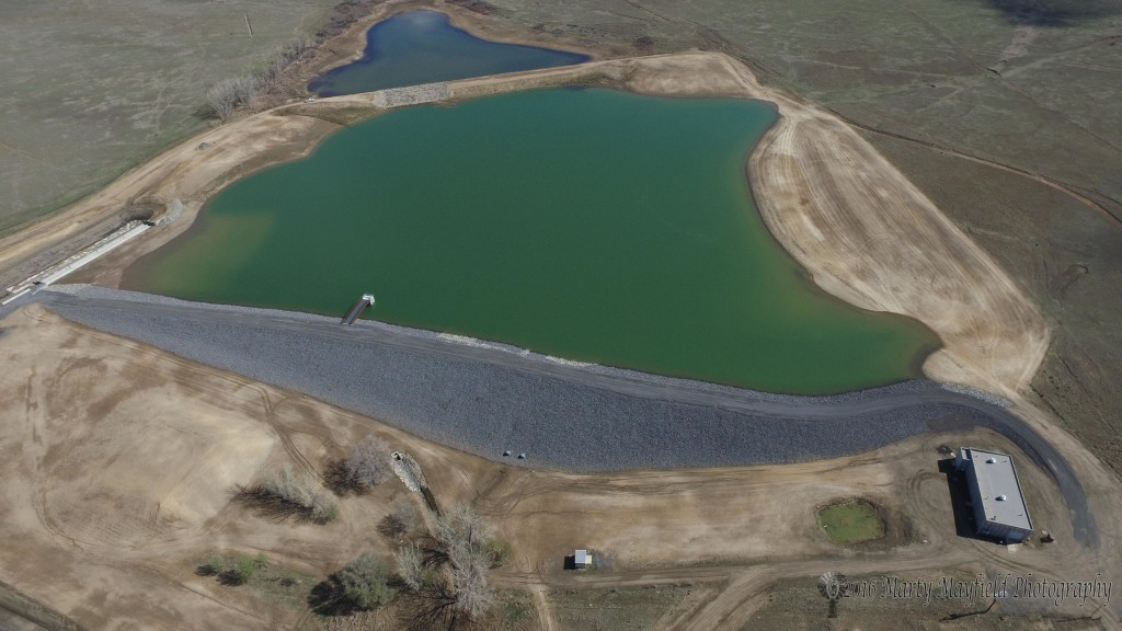 The new dam at the Springer city reservoir secures the future needs of Springer's water.