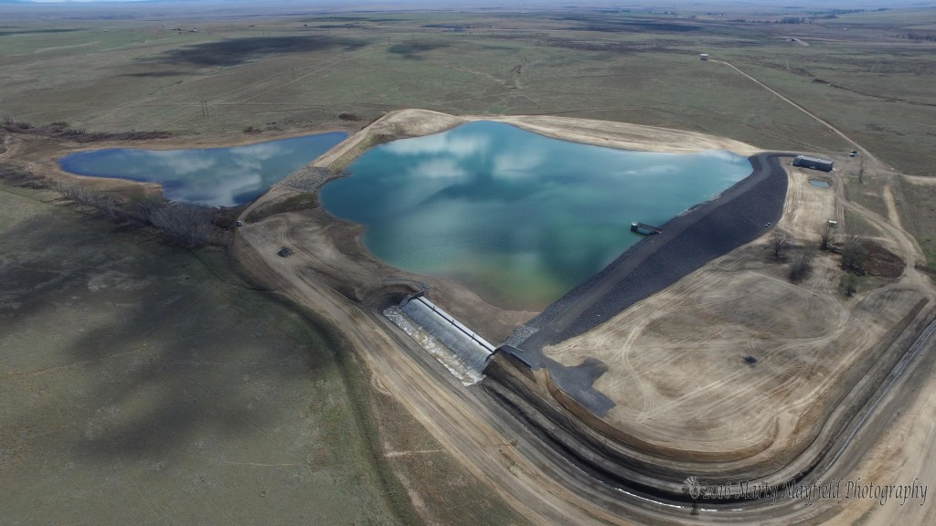 The newly completed dam for the Springer Reservoir will supply Springer with water for many years to come.