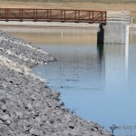 The new dam at the Springer Reservoir is more solidly built and meets the new dam regulations