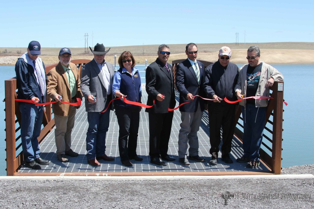 Several dignitaries were on hand at the Springer Reservoir to cut the ribbon for the new dam.