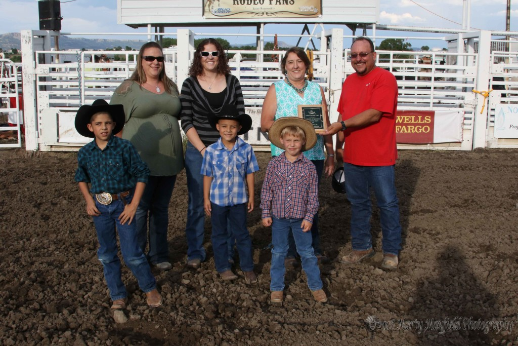 "The Raton Rodeo Association honored Leonard ""Big Daddy"" Lopez for all the support he gave to the rodeo in years past. Monty Colangelo presented the family with a plaque of their appreciation. L to R back Jamie Hephner, Ashley Long, Penny Lopez, Monty Colangelo, front row Colten Lopez, Tyson Lopez and Cooper King."
