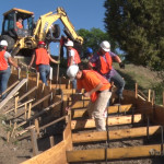 RHS YCC projects are under way at the Raton High School, here the students are preparing forms for the new stairway from the lower parking lot to the upper parking lot on the north side of the high school.