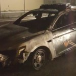 State Police vehicle burns after being struck while jump starting another vehicle