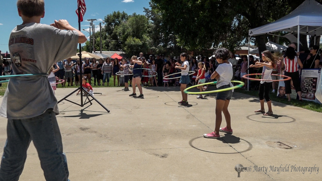 DJ Teddy Romero gets the kiddos involved in the Fun in the Park with a hula hoop contest