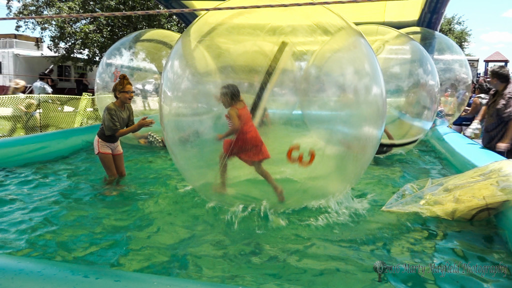 Lets cool off with this kids as they play in the bubble.