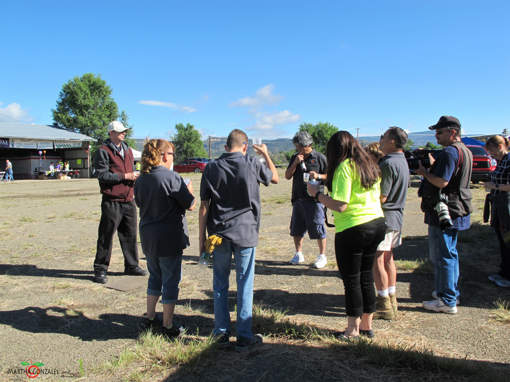Its a tradition in ballooning that all first time riders have an initiation ceremony after their first ride. Here the ballooning prayer and story are passed on to Frankie as he prepares for the ceremonial drink.. Photo By Martha Gonzales