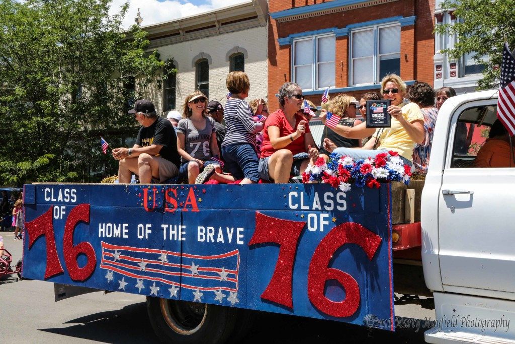 The Class of 1976 ride the parade for their 40th class reunion.