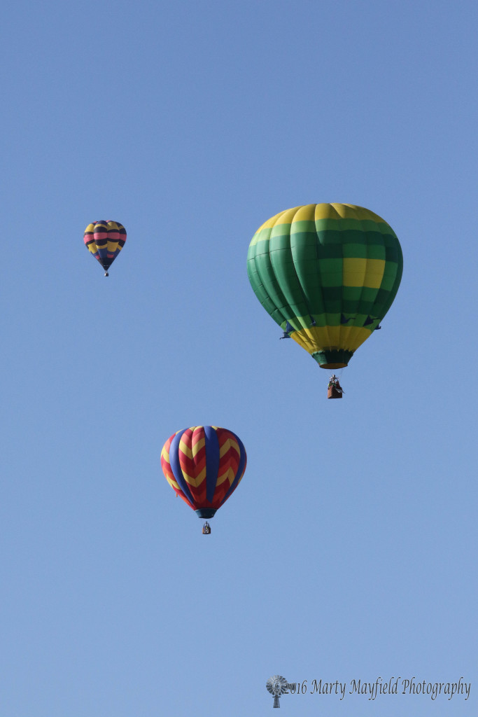 The Green Hornet, Saki Bomber and Highlighter float away to the south Monday morning during the 2016 International Santa Fe Trail Balloon Rally