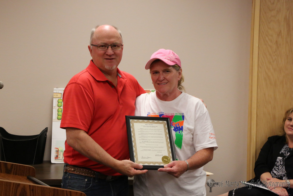 Jami Esquibel accepted the proclamation for the walk/run for the Cure at Roundhouse Park coming up August 13, 2016