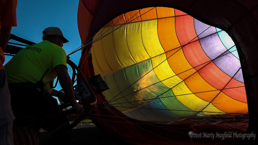 The hot air goes in as Pilot James Morgan heats up the balloon.