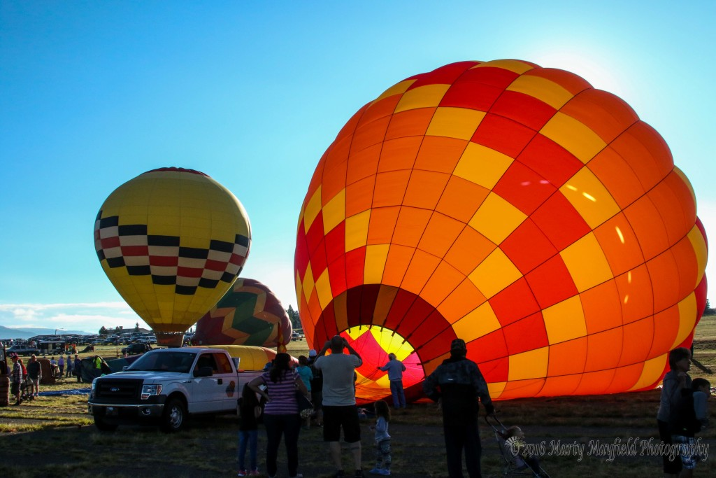 Balloons inflate on what was being called an great morning for flying.