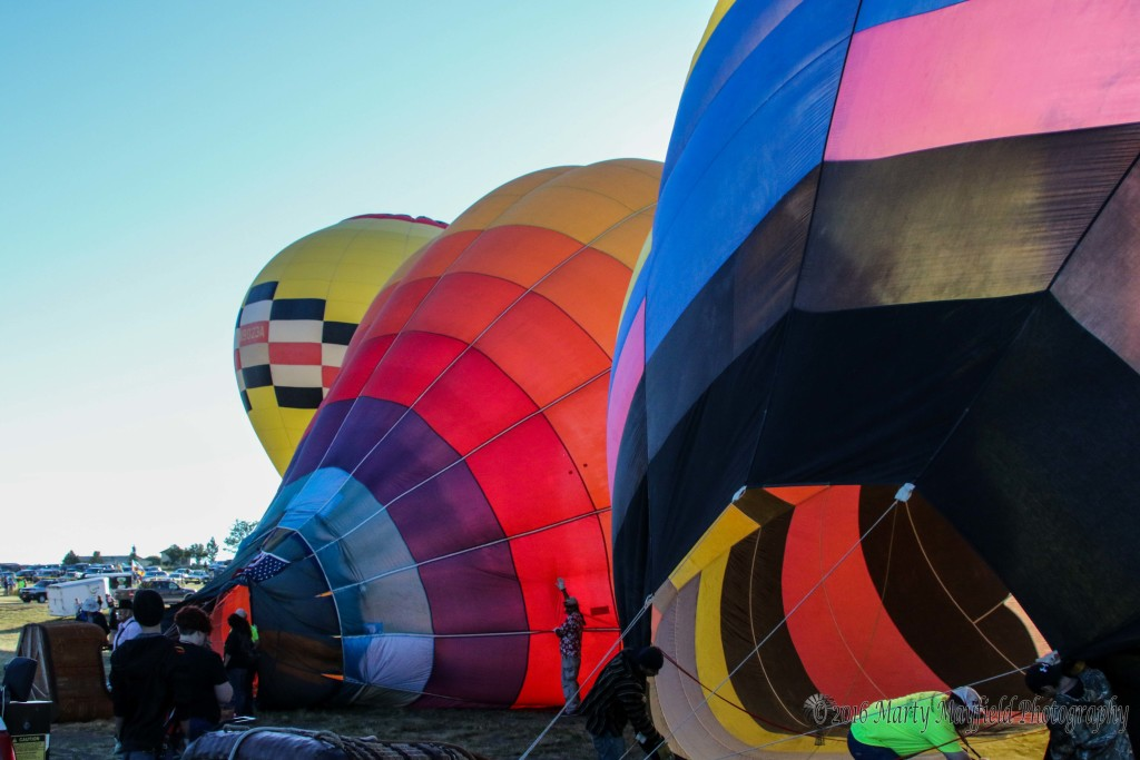 Sunday morning balloons inflate to what turned out to be another great morning for flying.