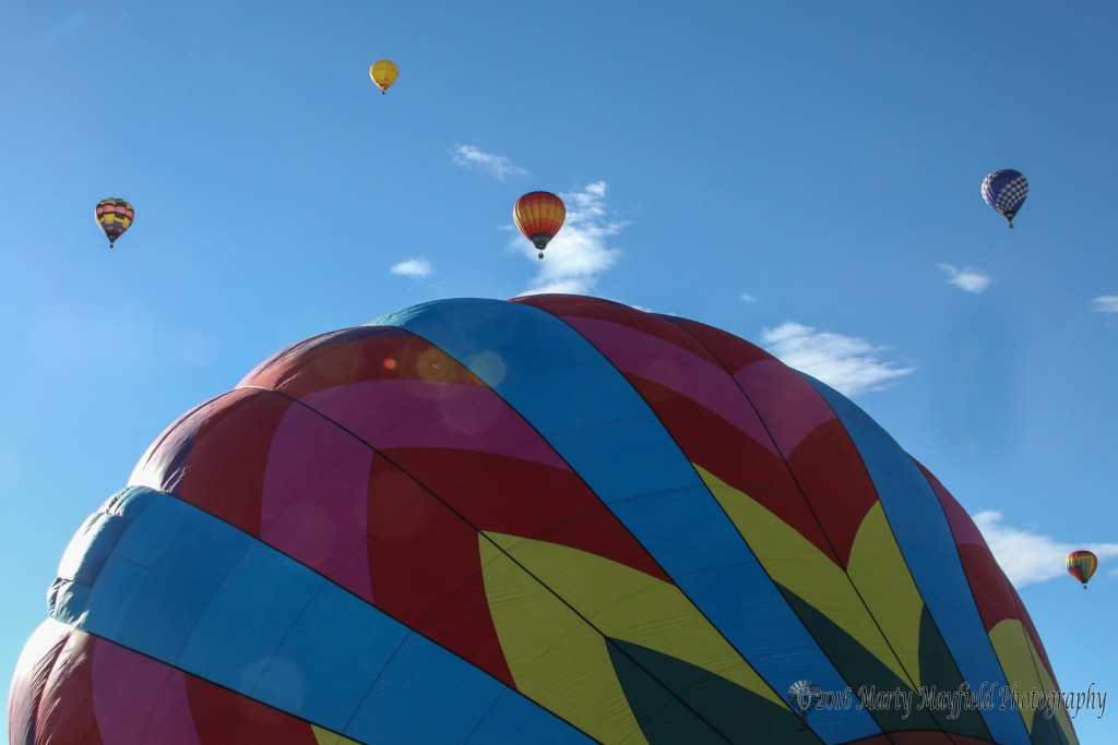Balloons encircle the Seeking Nirvana balloon as upper winds carried balloons to the south east during the 2016 International Santa Fe Trail Balloon Rally