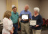 Mike and Sara Kowalski were presented the You Rock pin and certificate for their volunteerism around town from Commissioners Lindé Schuster and Don Giacomo.