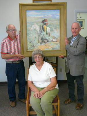 "Jim Segotta (left); Paul Kastler (right); and Diana Best (seated) were three of the former Raton School Board members from the 1980s who faced the tough decision of whether to keep or sell the painting. ""The Last Trail"""