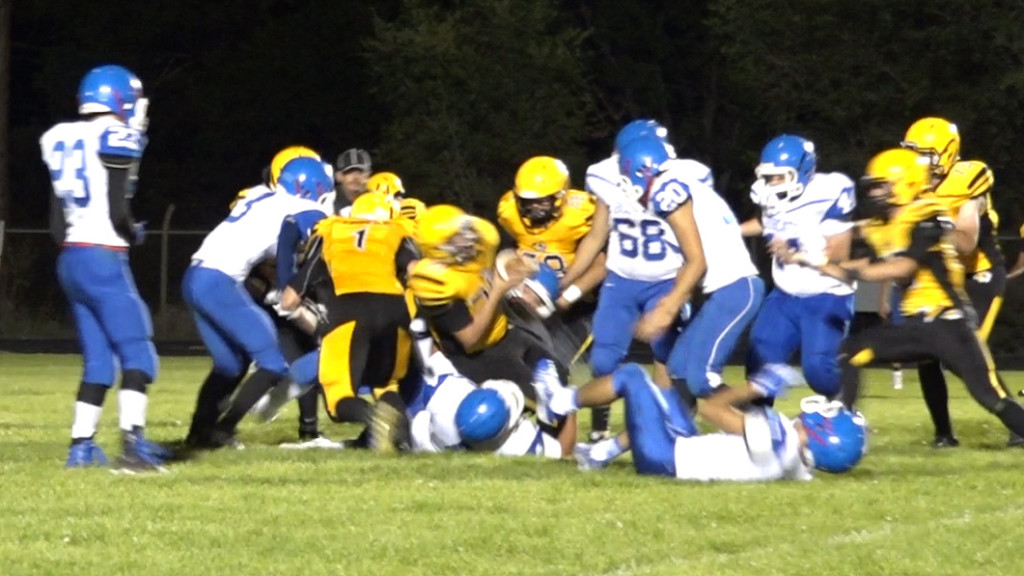 Tristen Gallegos falls across the goal line for six Tiger points