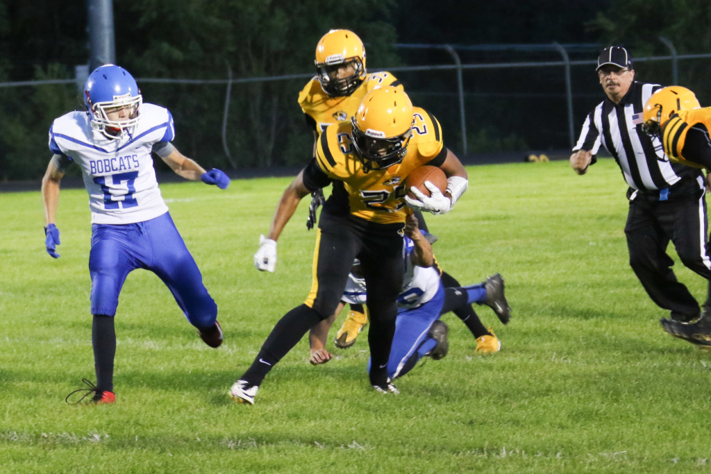 Jonathan Cabrieles rushed for over 100 yards Friday night. Here he just gets caught on his way for a big gain.