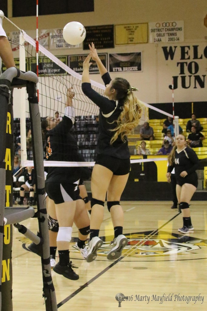 Camryn Stoecker gets the block as Aspin Borja catches a finger in the net to get called on a net violation during the RHS Tourney thursday evening in Tiger Gym