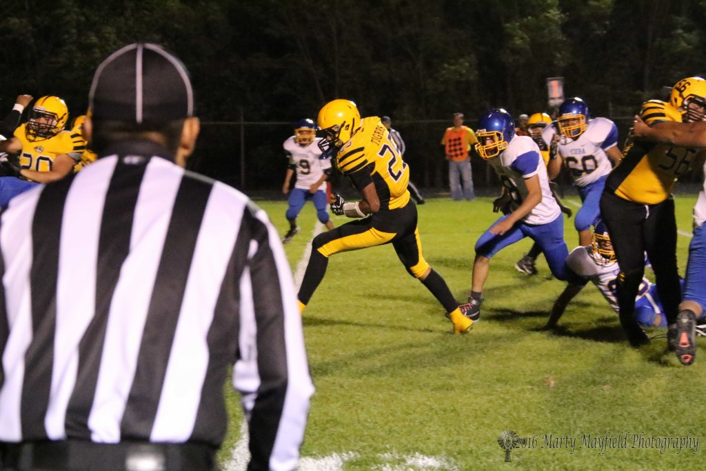 Jonathan Cabriales steps over the goal line in one of his many trips to the end zone Friday night against Cuba