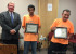 Wally Goss and Gilbert Vigil were honored for their volunteer work during the Gate City Music Festival with a You Rock Award.