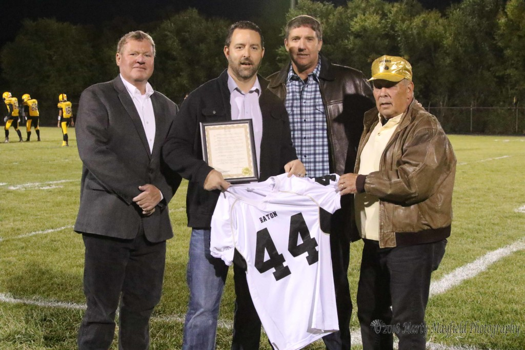 Raton City Manager Scott Berry, Mark Chicarelli, Former Raton Coach Tom Vertavec and Raton City Commissioner Ron Chavez honor Mark with a proclamation and a jersey fro Mark's accomplishments both on the field and in life.