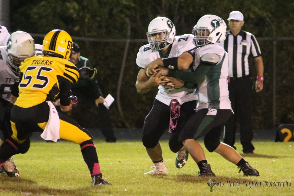 Big Senior Mason Golden(28) takes the handoff and plows up field, a force Raton had trouble dealing with all night.
