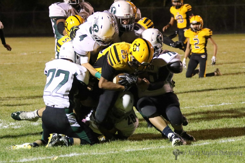 Jonathan Cabriales' run comes to an end as five Wolverines make the tackle.