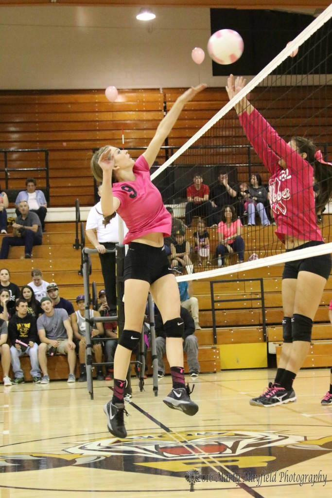 Alina Pilmore and Faith Flores meet at the net once again during the district match in tiger gym.