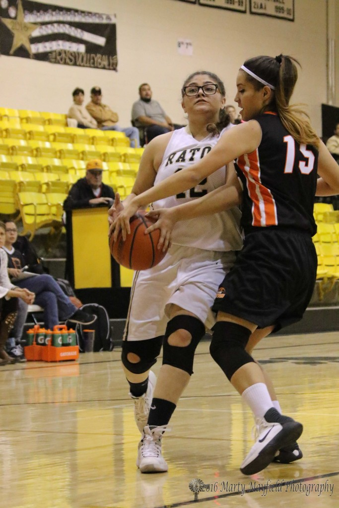 Dyanne Montoya (15) gets a hand on the ball as Mariah Saenz moves toward the lane for a shot during the JV game Monday afternoon.