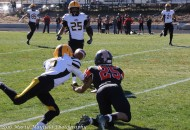Richie Acevedo and Jacob Smith meet for the ball early in the state playoff game in Capitan Saturday afternoon where Acevedo almost intercepts the ball.