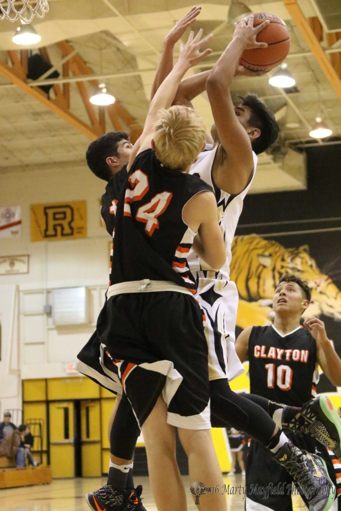 Austin Jones goes up for the short jumper as Tyler Drumm jumps for the block.