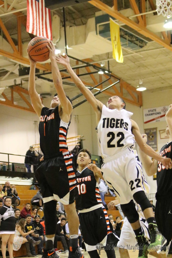 Clayton's Jacob Naranjo brings the rebound down as Richie Acevedo reaches for the ball.