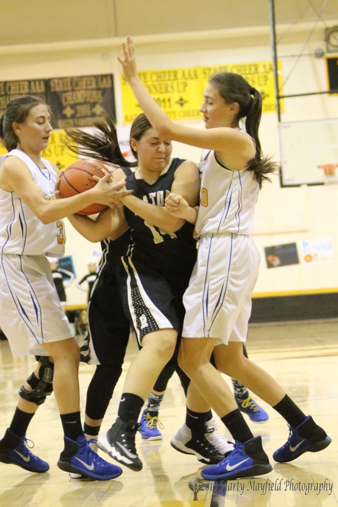 Its a tussle for the ball as a host of Lady Panthers surrounding Raton's Andie Ortega work for the ball.