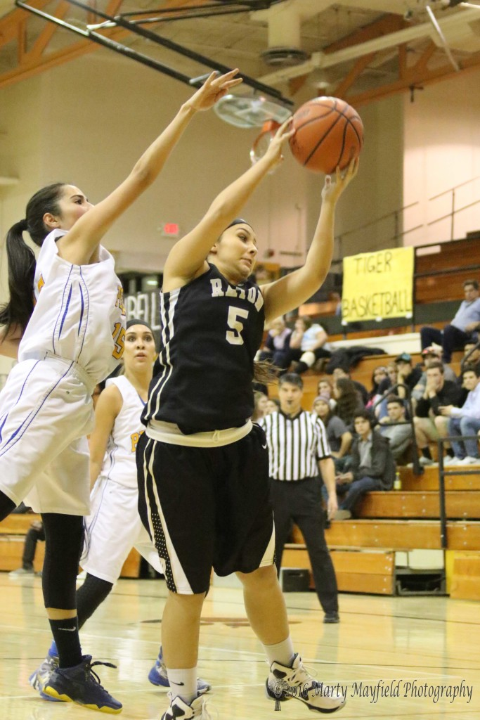 Sofia Maddaleni (5) gets the rebound as Adrianna Tafoya (15) reaches for the ball during game 13 of the 2016 Cowbell