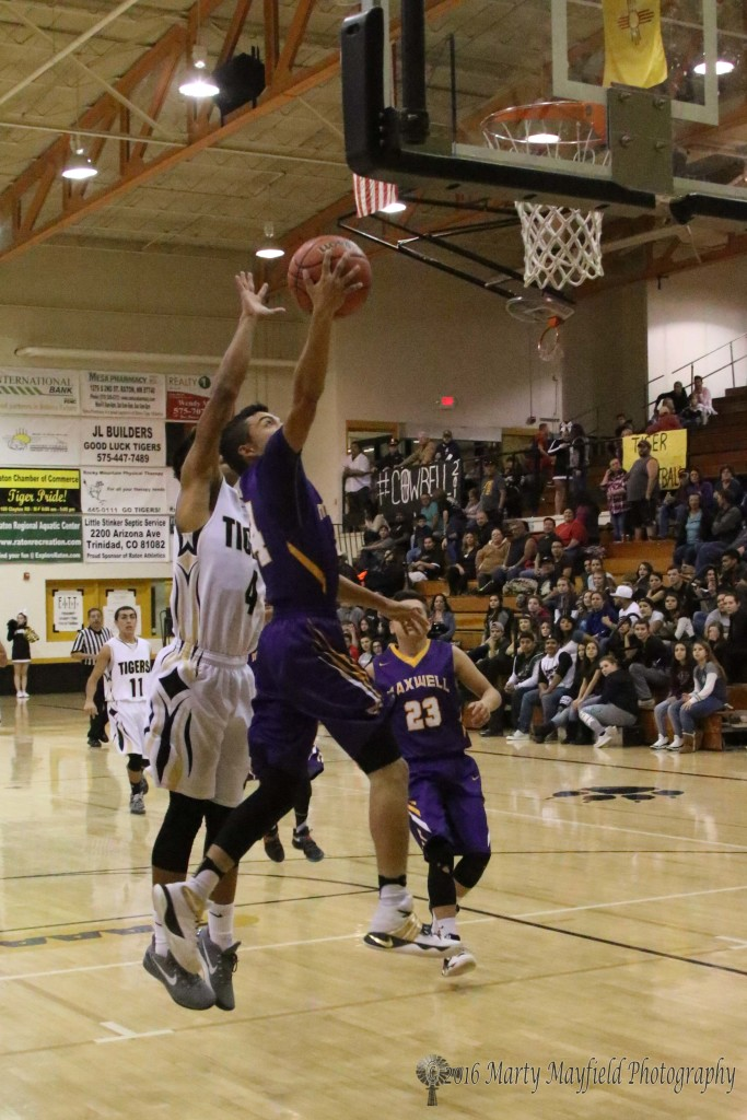 Andrew Archuleta goes for the lay-up as Jonathan Cabriales works for the block during game 16 of the 2016 Cowbell in Raton