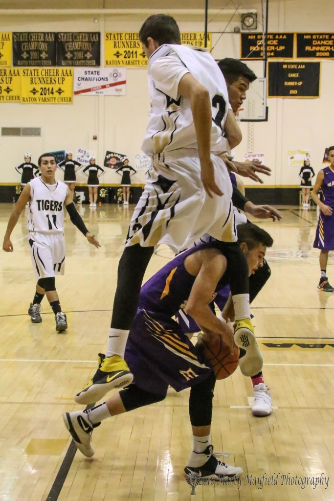 Aiden Vanderwater and Jonathan Cabriales go up as Jeremy Archuleta works under the two as he heads for the basket.