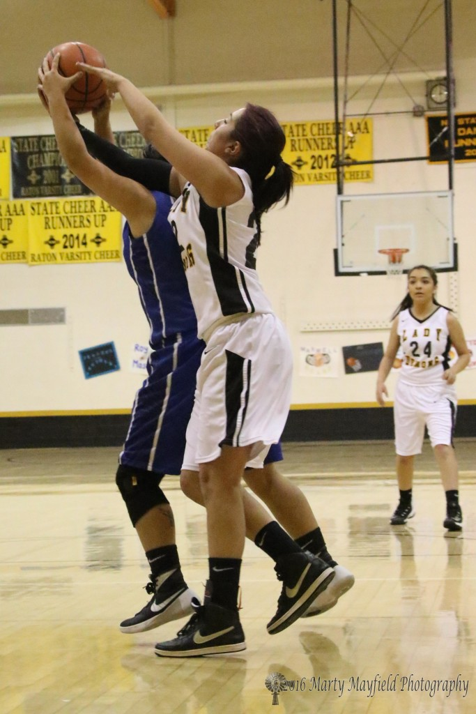 Alexis Wingo gets a hand in on the rebound with Kassandra Valarde Saturday during the 2016 Cowbell