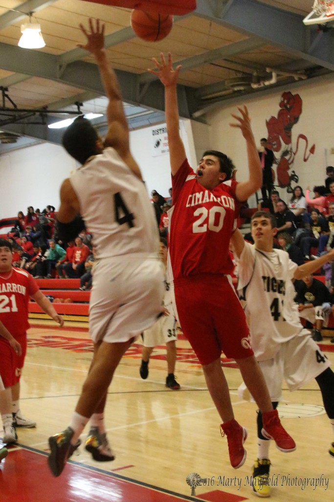 Austin Vargas takes the shot as Jonathan Cabriales goes for the block.