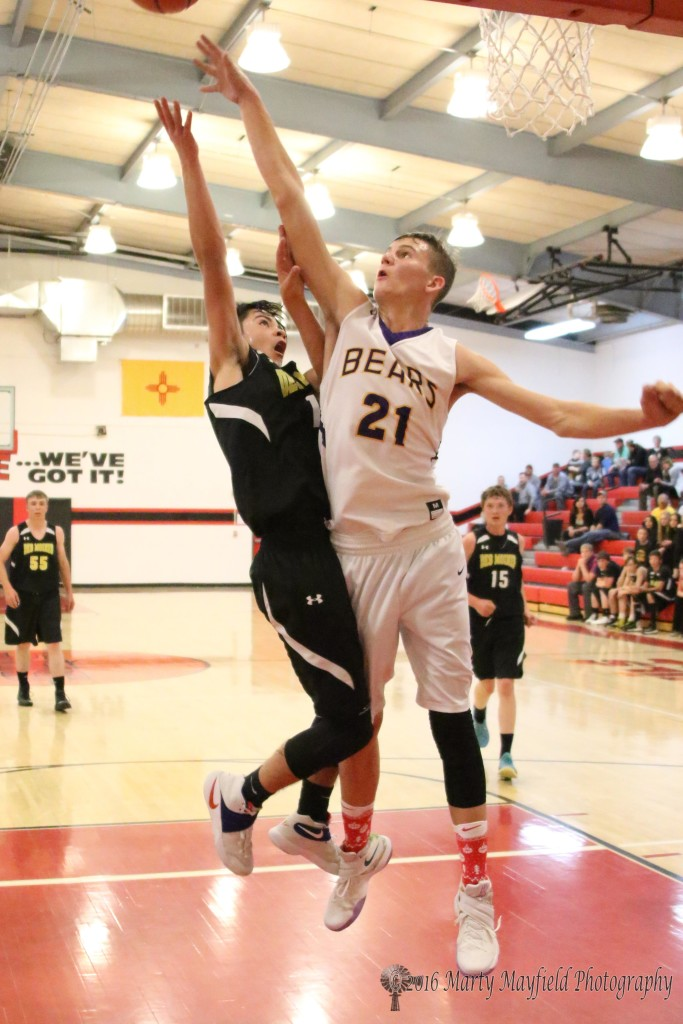 Colton Riggs (21) makes the block this time against Isaiah Trujillo as he did several times during the evening