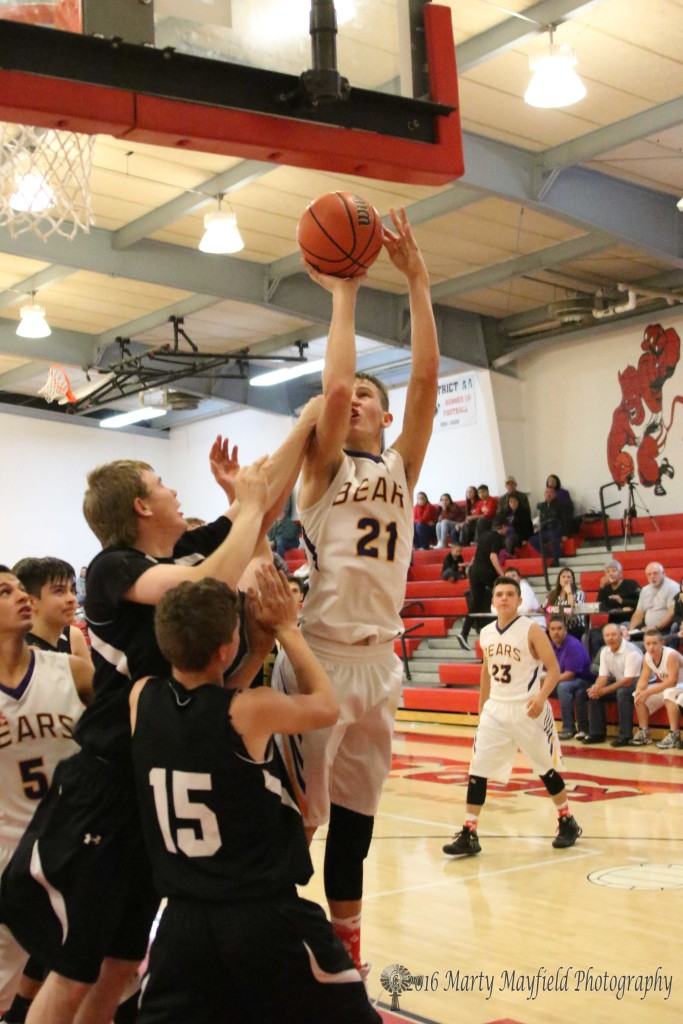 Colton riggs takes the ball to the basket as Several Des Moines Demons try to block the way in game four of the 2016 Cowbell in Springer Tuesday evening.