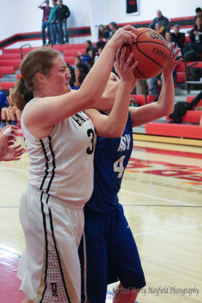 Jadyn Walton (33) and Sherry Ray struggle for the rebound Wednesday evening in Simm Brown Gym in Springerduring the 2016 Cowbell