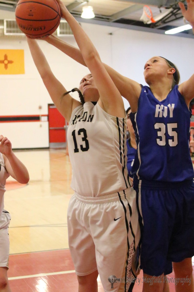 Halle Medina (13) and Haley King (35) reach for the rebound late in game 7 of the 2016 Cowbell