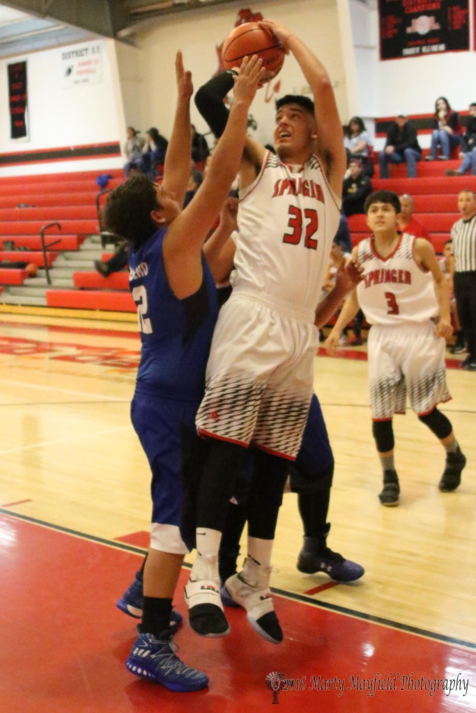 Zac Caldwell goes up for the shot as Tyler Overburger attempts to disrupt his flow during game 8 of the 2016 Cowbell