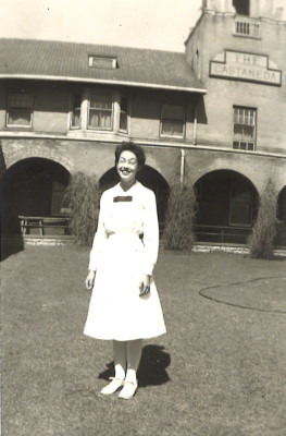 Nina Strong, Harvey Girl, in her crisp, white uniform (La Castaneda is in the background.)