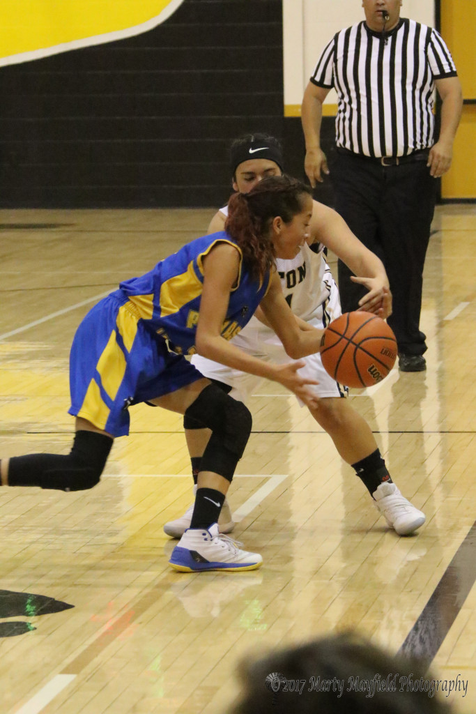 Ashley Zamora gets a hand on the ball for the steel as Becca Muniz brings the ball down the court