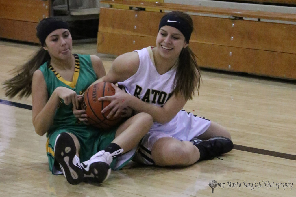 Montana Trujillo and Joselyn Tapia meet on the floor for the ball during the JV game in Tiger Gym Saturday afternoon