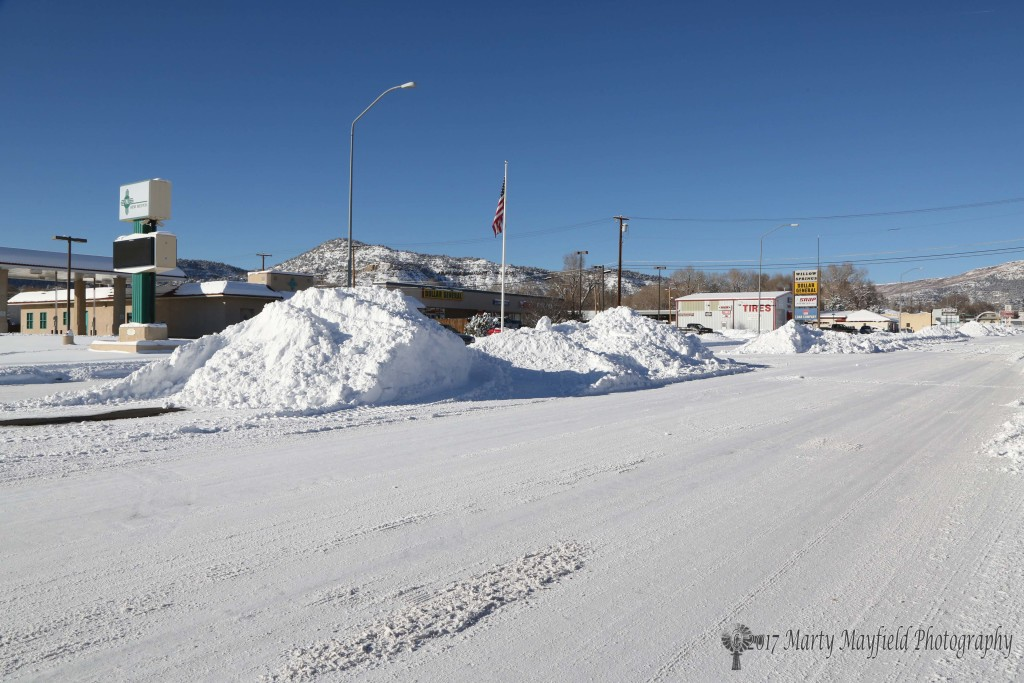 "A sight not uncommon in the winter time in Raton as snow is piled up in the middle of Second Street. What was unusual was the amount of snow, 13"" of the white stuff."