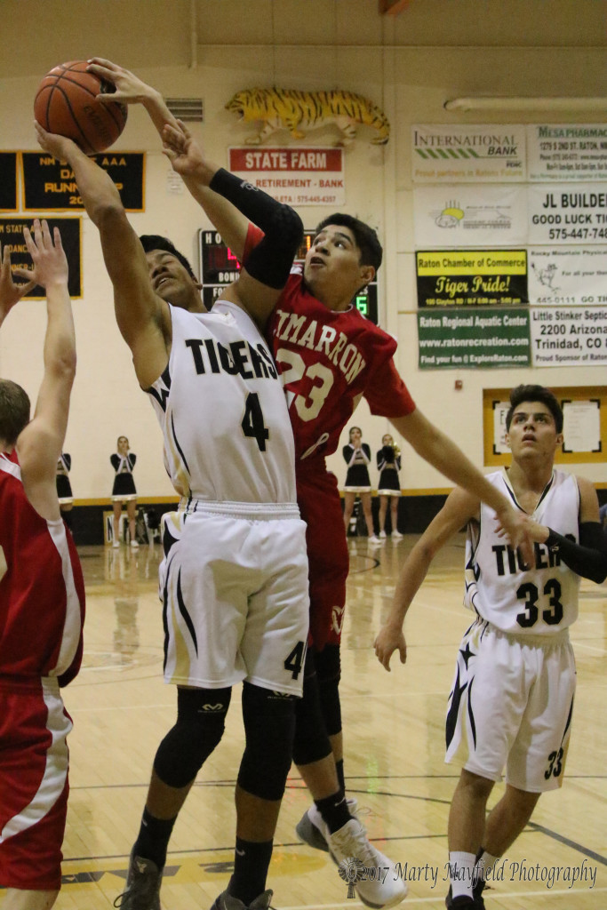 Anthony Waggner (23) gets a hand on the ball as Jonathan Cabriales (4) goes in for the shot, the play sends Cabriales to the free throw line to shoot two.