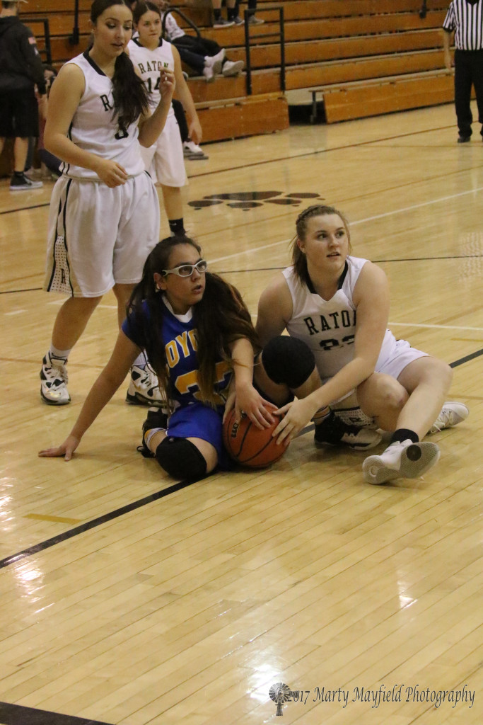 Kerrigan Weese and Angelica Ornelas look to see the referee call the tie ball as they struggled for the ball during the varsity game Thursday evening in Tiger Gym. Sofia Maddaleni looks on from behind.